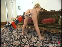 Kiki Daire likes to spread her legs wide open and get her ass fucked with a fucking machine